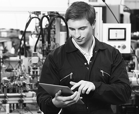 Engineer In Factory Using Digital Tablet